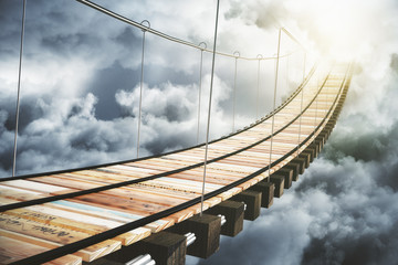 Zelfklevend Fotobehang Brug Wooden bridge in the clouds going to sunlight, concept