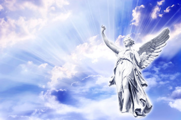 Wall Mural -  angel in the sky with divine rays of light