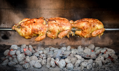 Cooking 3 rotisserie chicken on the grill with Charcoal and Briq