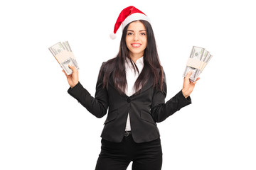 Businesswoman with Santa hat holding money