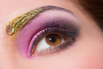 Close-up of woman's eye with creative make-up