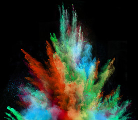 Launched colorful powder on black background