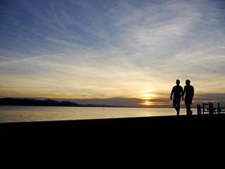 couple walking sunset
