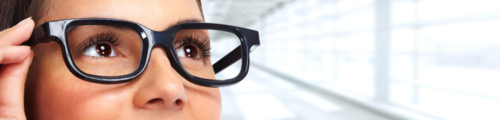 Beautiful woman eyes with eyeglasses.