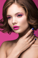 Beautiful model girl with bright makeup and colored  nail polish. Beauty face. Short colorful nails