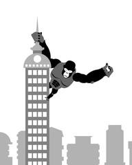 King Kong on building. Strong big gorilla keeps Spire skyscraper