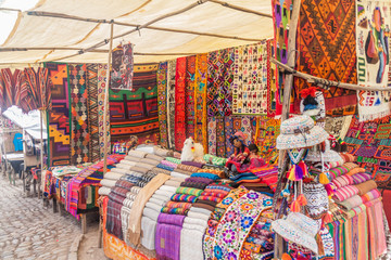 Famous indigenous market in Pisac, Sacred Valley of Incas, Peru.