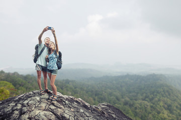 Hikers on the rock with camera