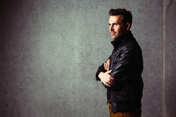 Confident man in leather jacket