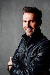 Portrait of happy man in leather jacket