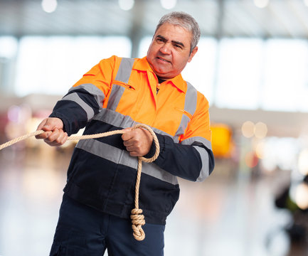 portrait of a worker pulling a rope