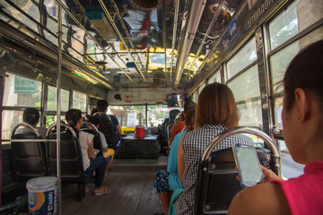 Thai people on open-air BMTA bus
