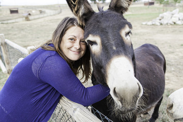 Woman with brown donkey