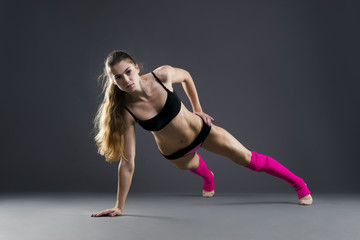 Beautiful muscular woman doing exercise plank