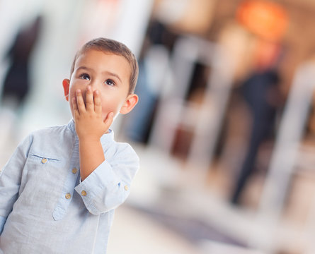 portrait of a little boy with surprised gesture