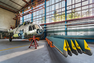 Wall Mural - Helicopter repair stand in the hangar