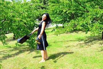 Woman in black in the Vilnius city sakura garden