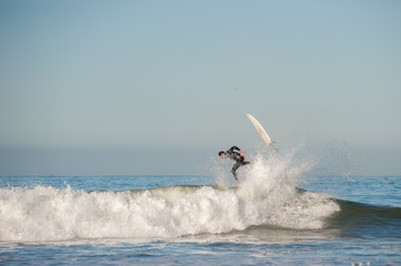 Surfer and board flying in opposite directions.