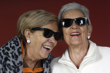 two seniors woman with sunglasses