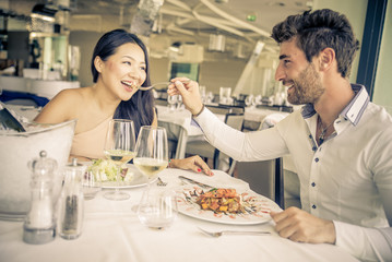 Young couple eating in a restaurant.