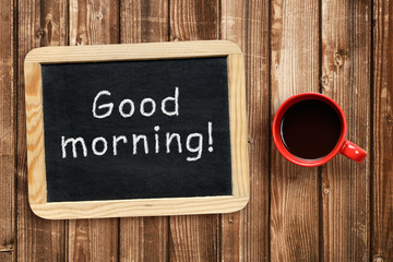 Good morning text on small blackboard and coffee cup