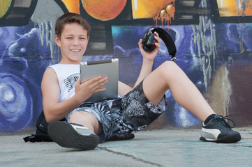 Teenager listening to music with tablet