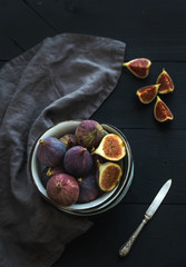 Rustic metal bowl of fresh figs on dark background, top view, selective focus