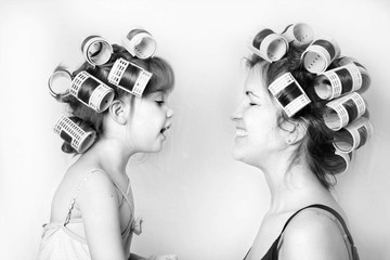 vintage image of a mother and daughter wearing rollers in their hair and having a good time Wall mural