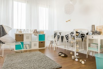 Infant bedroom with white furniture