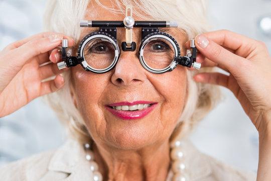Senior woman in optician's office