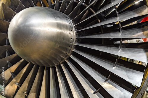 Wall mural Engine turbo fan in aviation hangar. Side view of plane jet engine