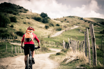 Mountain bike rider on country road, track trail in inspirationa Wall mural
