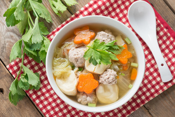 Clear Soup with Vegetables and Meatballs. Top view.