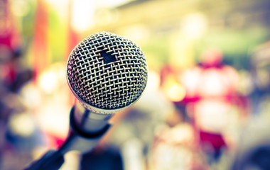 Old microphone in front of colorful background, Selective focus and Close up detail image