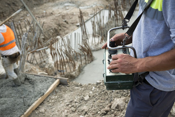 Concrete pump operator with remote control for boom pump truck