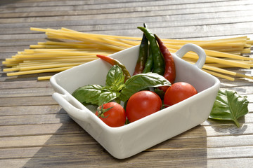 Ingredients for spaghetti with tomato sauce and hot pepper