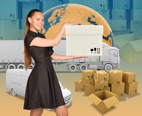 Smiling businesswoman holding white box