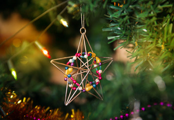 Christmas star baubles on a tree