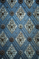Vintage ancient background. Rustic ancient doors pattern medieval repetitive ornaments.