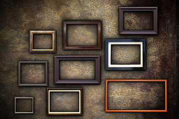 picture frames on abstract rusty wall