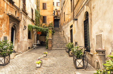 romantic alley in old part of Rome, Italy