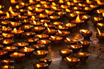 Burning candles in Buddhist temple. McLeod Ganj, Himachal Prades