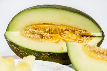 "Sliced Santa Claus melon, also known as ""toad skin"" due its green-striped rind"
