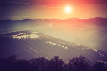 Mountain winter landscape. Fantastic evening glowing by sunlight.