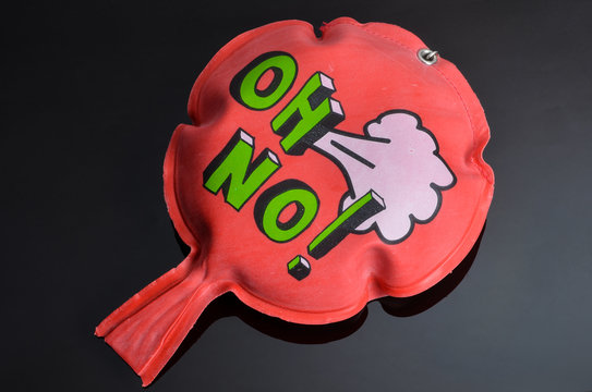 red whoopee cushion with reflection on black glass