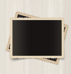 Vintage photo frames  on a wooden background