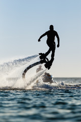 Acrylic Prints Water Motor sports Silhouette of a fly board rider