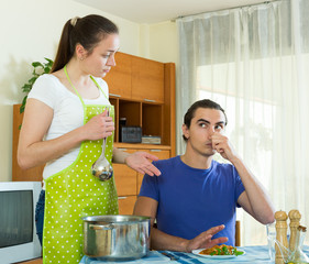 woman serving food her man at table