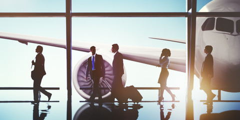 Silhouettes of Business People in the Airport Concept