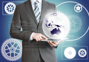 Man using tablet with planet and cog wheels